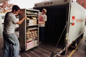 Wisconsin Union Food Service student staff loading trucks to transport food.