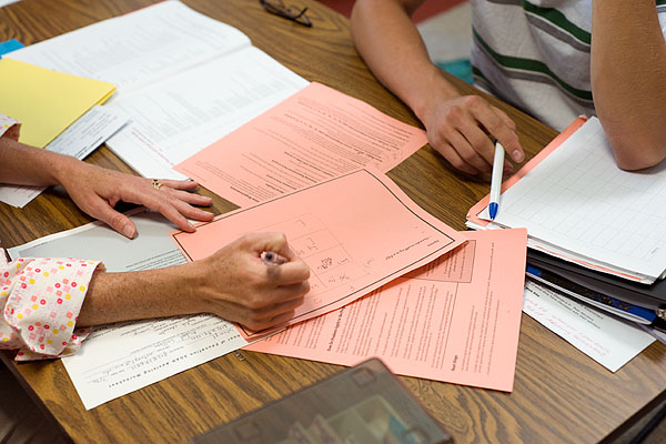 Image of students filling out forms