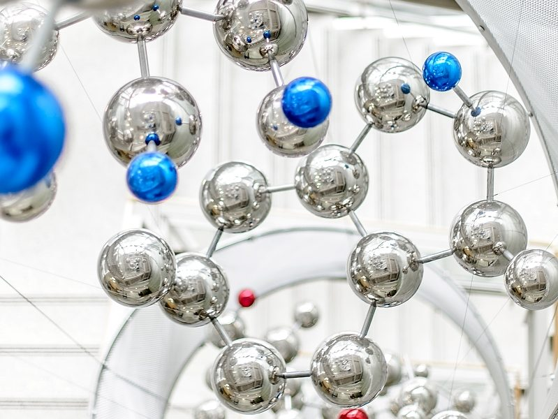 Art piece of metallic molecules connected together.