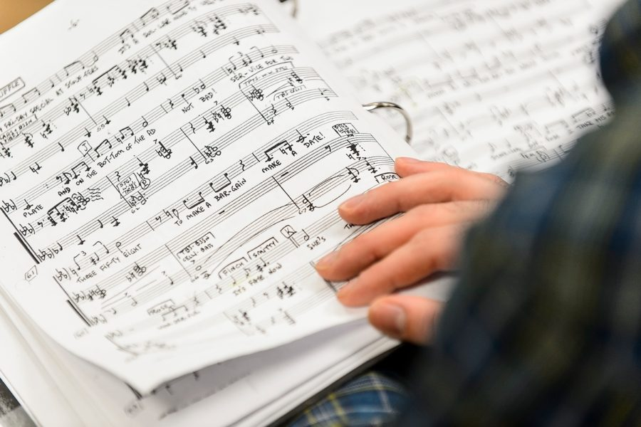 Student reads sheet music.